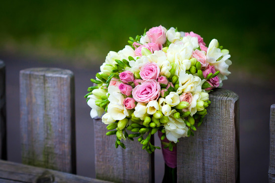 wedding bouquet on rustic fence