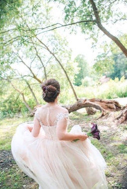 Bride in wedding dress running into forest