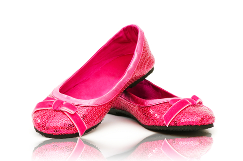 elegant pink flat shoes isolated on white