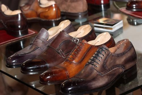 mens luxury leather shoes on store shelf