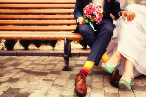 modern bride and groom on bench