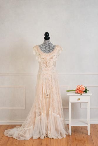 soft peach wedding dress hanging